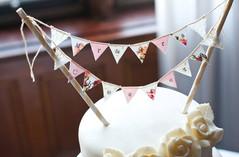 Bespoke wedding cake bunting by Emma Bunting