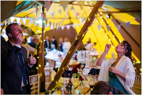 Vintage style wedding bunting in a tipi