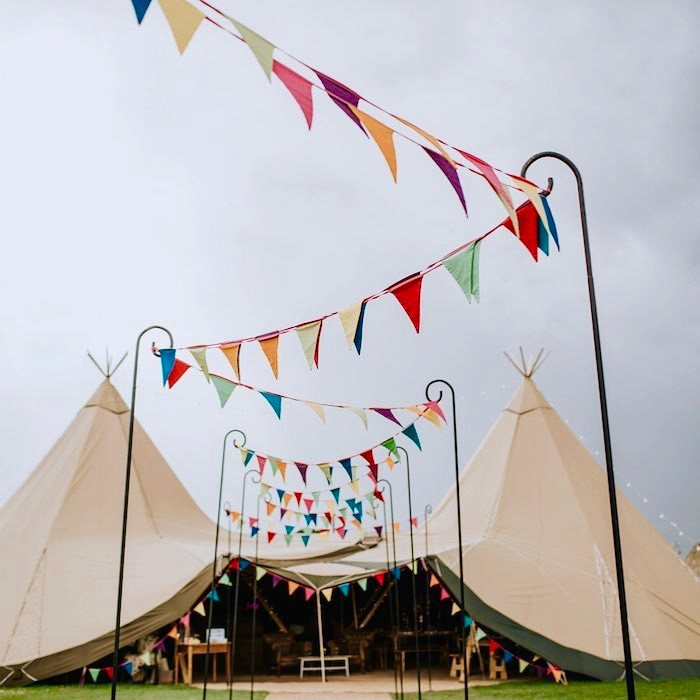 Rainbow bunting outside tipi.jpg