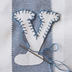 An example of our hand-stitched bunting letters