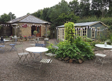 Vintage bunting outside at Blagdon Parlour