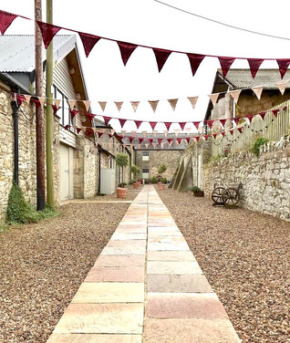 Burgundy and Gold sequin bunting at Doxford Barns
