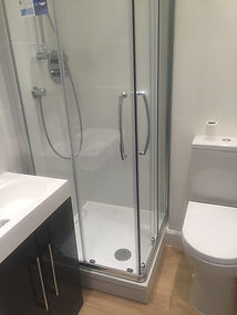 Shower units, sinks, toilets installed along with all the supporting plumbing
