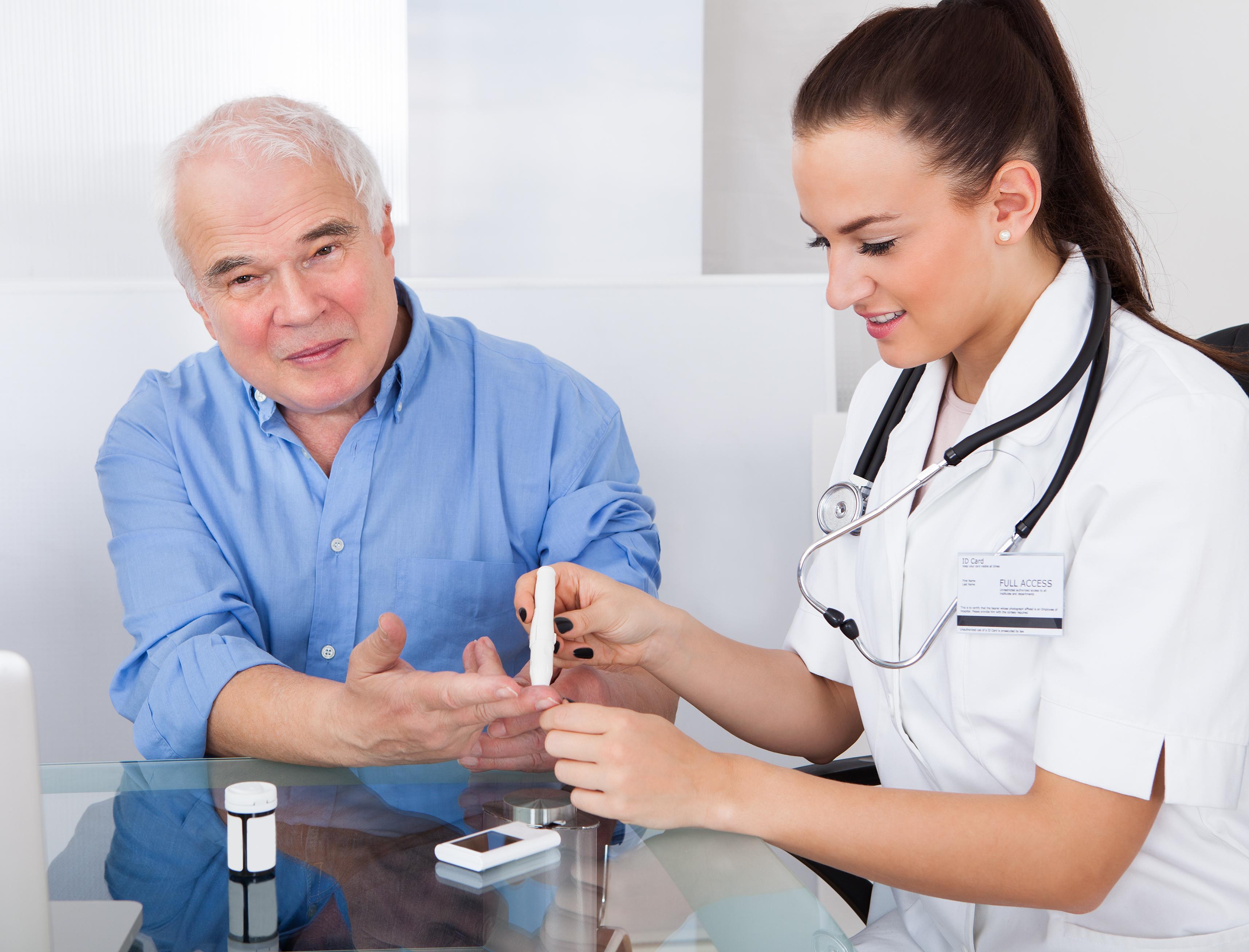 Female doctor using lancelet on senior m