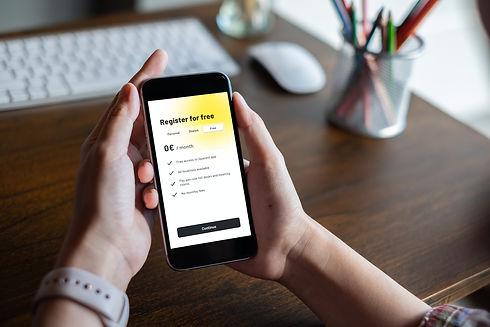 Phone-hand-register-for-free.jpeg