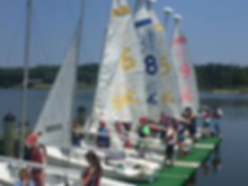 Brendan Campers Prepare for Departure with Sailboats at the Dock