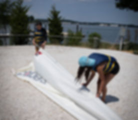 Campers fold the sails at the Brendan Sailing Program in Annapolis, Maryland