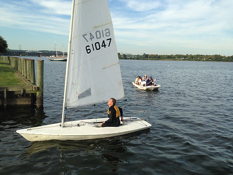 Dinghy Sailor Approaching the Dock