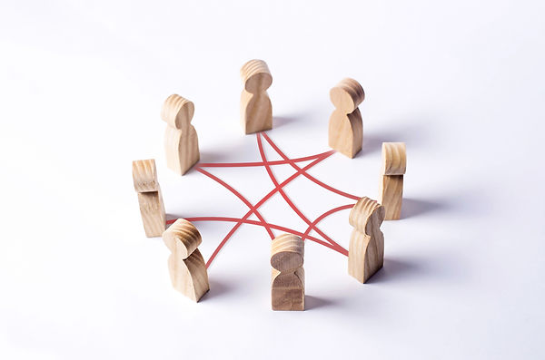 Circle of people interconnected by red c