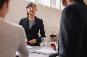 np_Young Asian businesswoman interacting