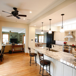 Clerestory with black and white cabinets