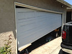 garage door off track repair Placentia  CA