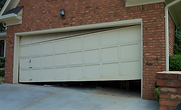 garage door off track repair tustin ca