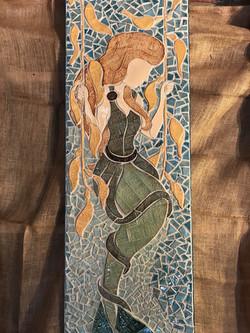 Mermaid on a kelp swing