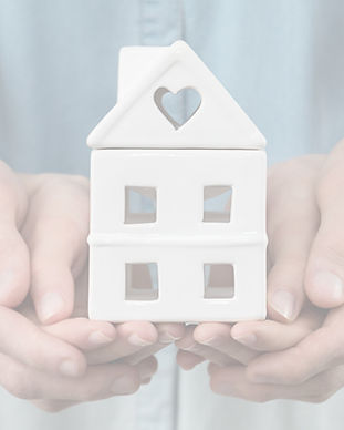 young-family-is-holding-house-in-hands_t