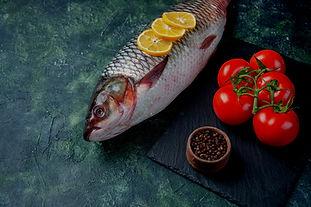 front-view-fresh-raw-fish-with-lemon-sli