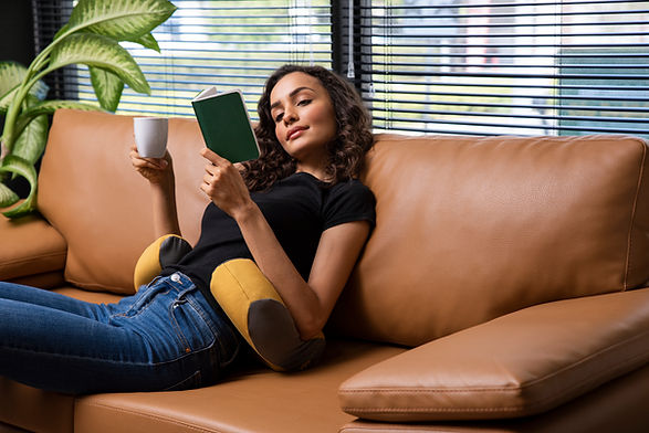 Girl sitting on couch with Modus support