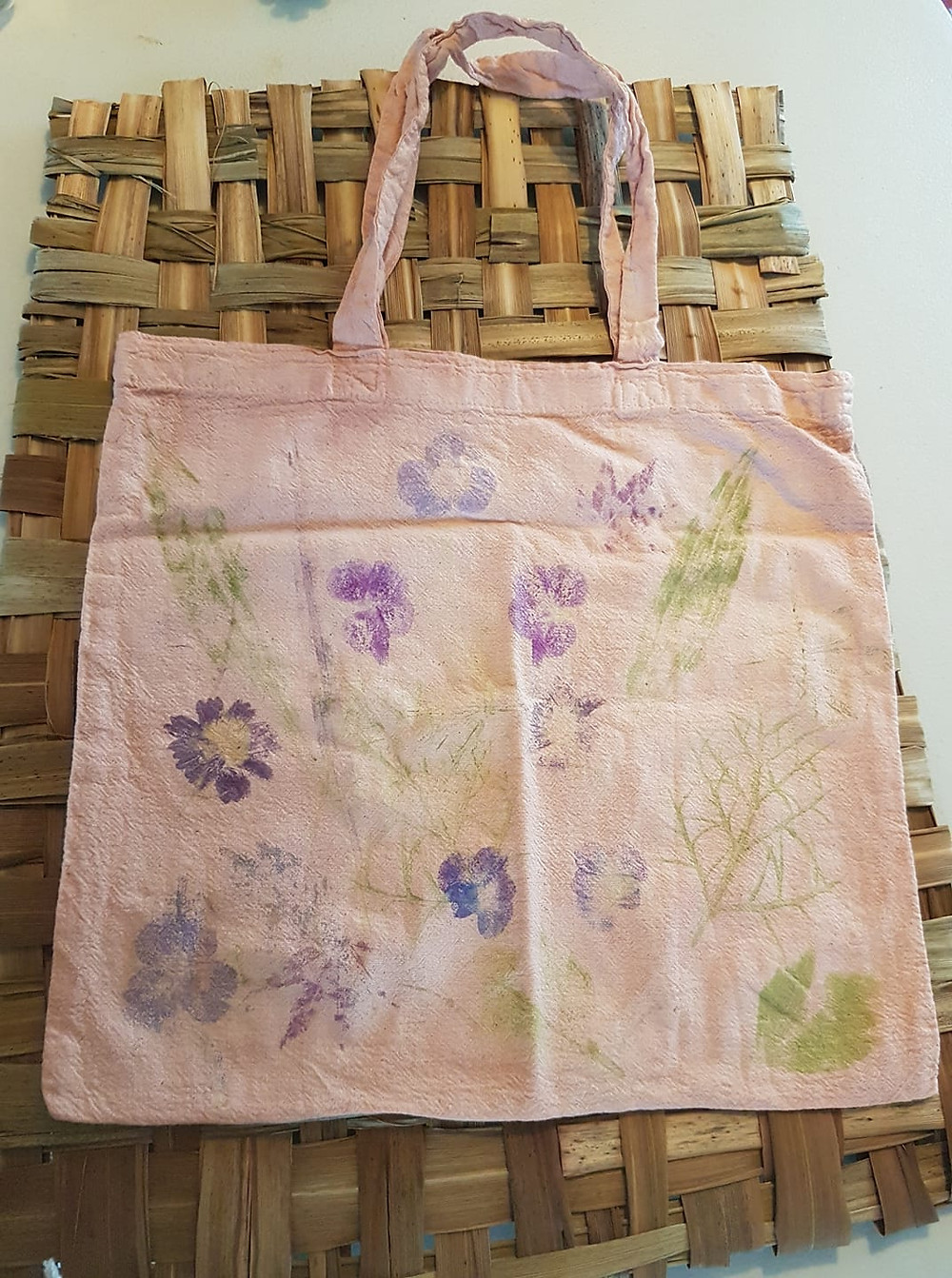 Cottage garden plants beaten into fabric. Cosmos, Geranium, Plantain leaves. Bag dyed with madder