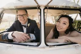 Married couple in the windows or splitscreen VW Kombi
