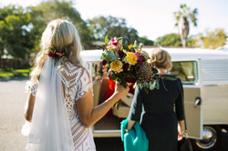 Bride approaching VW Kombi