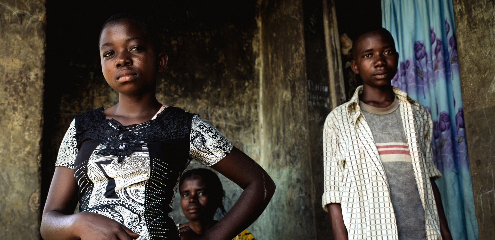 A family in front of their house in Kananga.