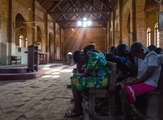 People from the village of Kananga praying during a friday afternoon.