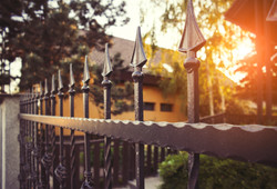 bigstock-Wrought-Iron-Fence-131946824