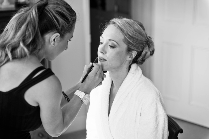 Wedding hair and makeup artist in action.jpg