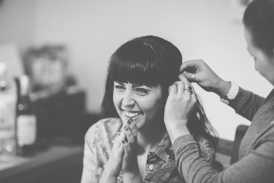 Excited bride getting hair fixed.jpg