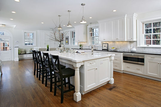 Custom white kitchen with calacatta marble countertops and stainless steel high-end appliances