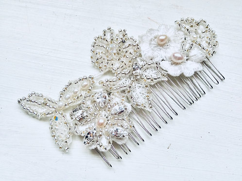Embroidered comb
