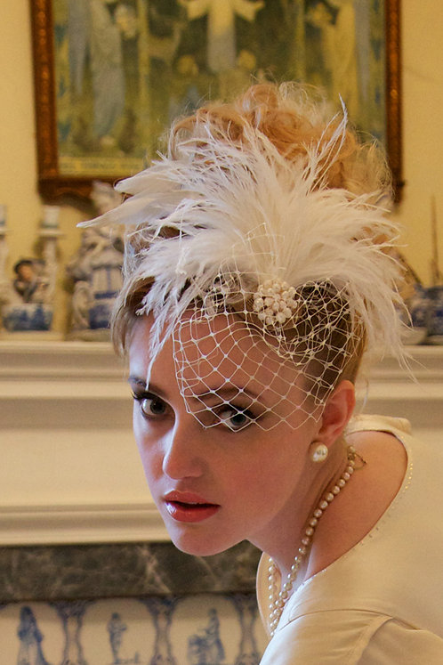 Ivory fascinator with bird cage veil