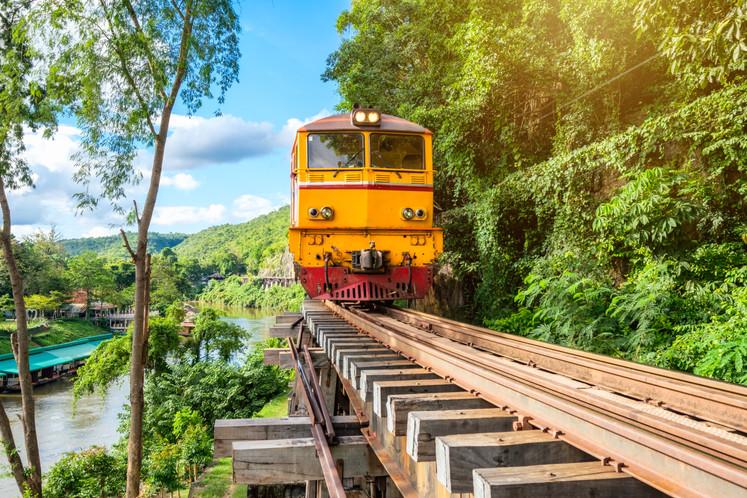 Ancient train running on wooden railway in tham krasae.jpg