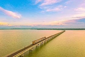 aerial-view-trains-pass-across-lake-dam-sunset-sky ย่อแล้ว.jpg