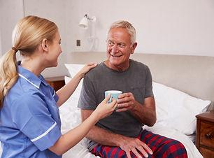 Nurse-Making-Home-Visit-To-Senior-Man-In