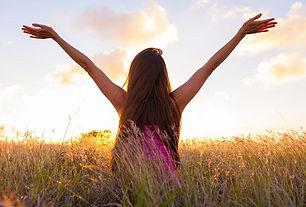 girl-raising-her-hands-thanking-her-life