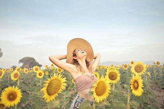 woman-standing-on-sunflower-field-376457