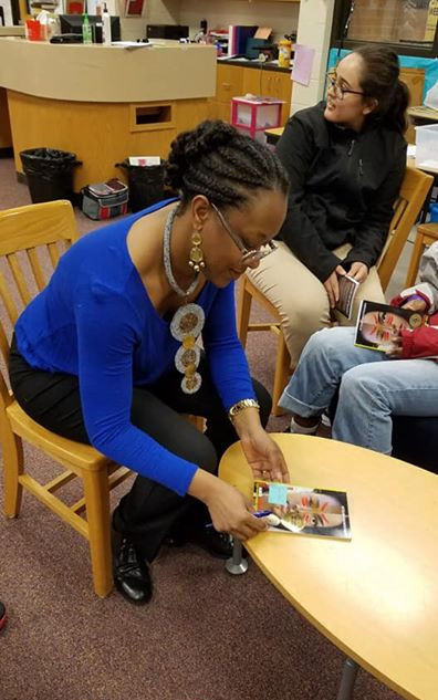 Signing books for Millwood HS Book Club