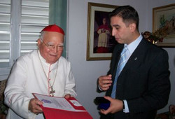 Junto al cardenal Aponte