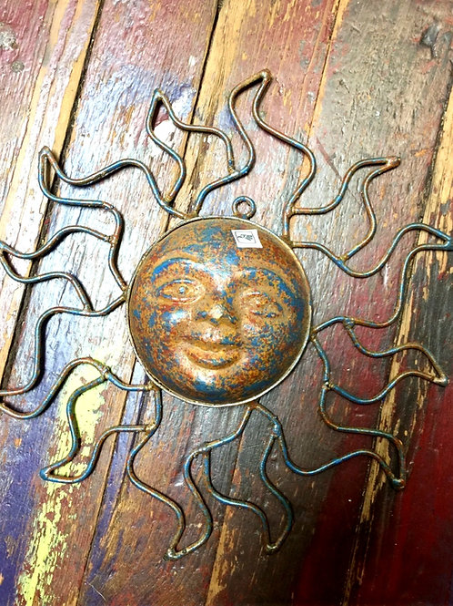 metal and terra cotta sun
