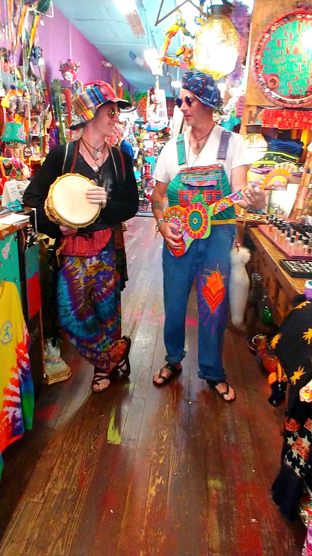 two bohemian hippies playing a guitar and a djembe  drum