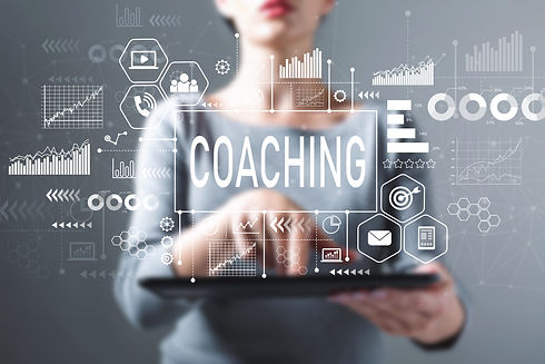 Coaching with business woman using a tab