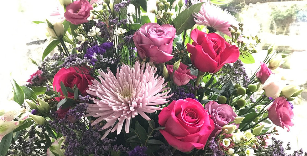 Fresh seasonal flowers arranged into a  pot or jute bag