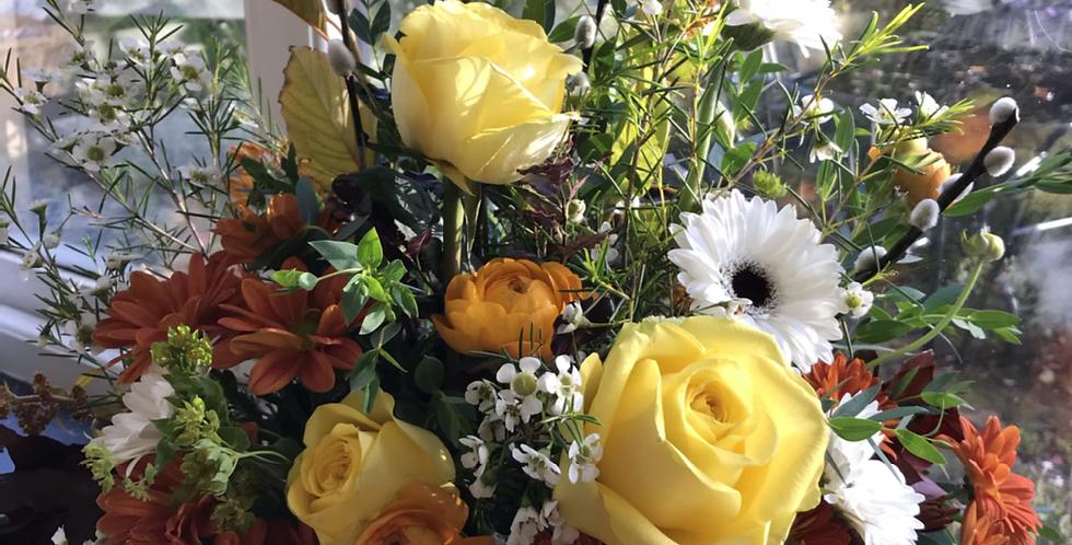 Large gift basket of Seasonal blooms