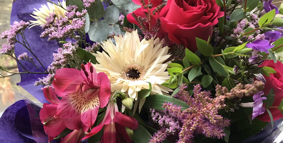 Beautiful bouquet of seasonal blooms, hand tied in water in a gift bag or box