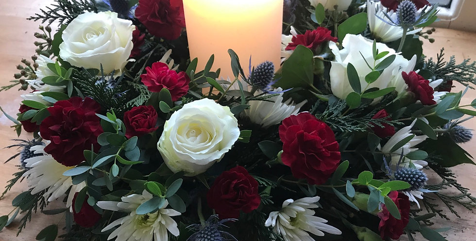 Large Christmas table arrangement with candle
