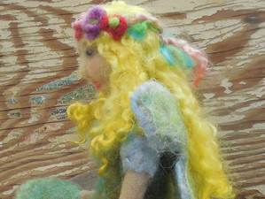Sweet needle felted fairy with wet felted gown and wings.