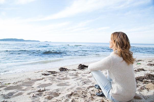 Lady sitting on beach .jpg