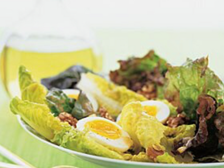 Red romaine salad with walnut and eggs