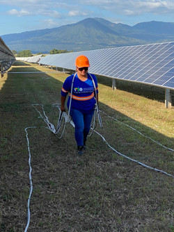 woman working into a solar park